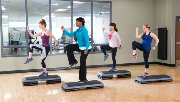 Group Exercise class with light barbels